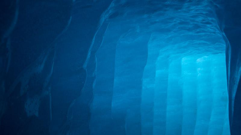 An image from Ice Music, photographed by UNC Professor Brooks de Wetter-Smith within a Swiss glacier