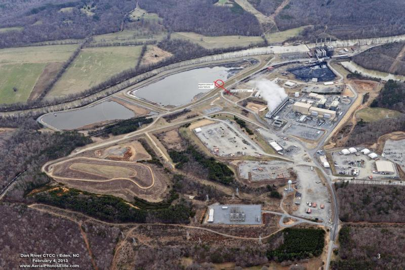 An aerial view of the Duke Energy plant next to the Dan River, which in 2012 stopped using coal to generate power. The first of the two coal ash basins (center left) was built in the 1950s.