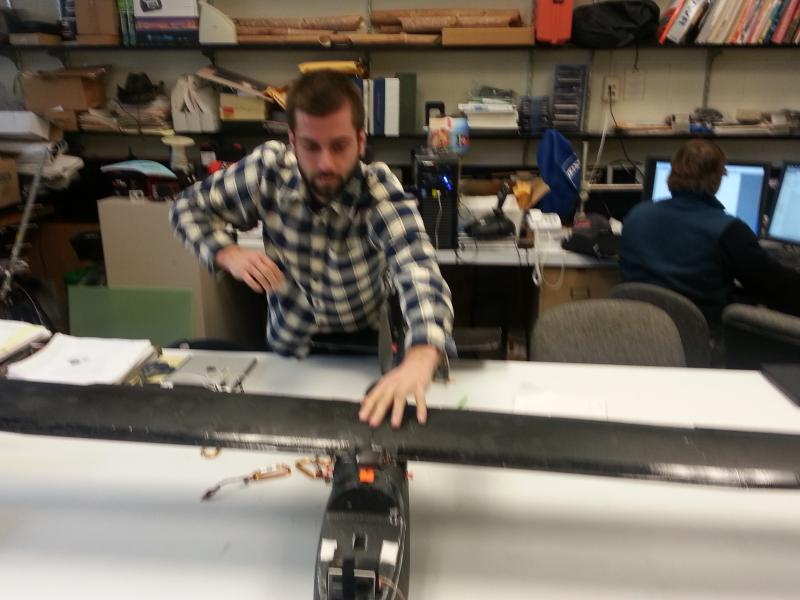 Wake Forest University graduate student Max Messinger shows the unmanned aerial vehicle he flew over the coal ash pond where a spill took place earlier this month. A group at WFU provided an independent estimate of how much coal ash spilled into the Dan R