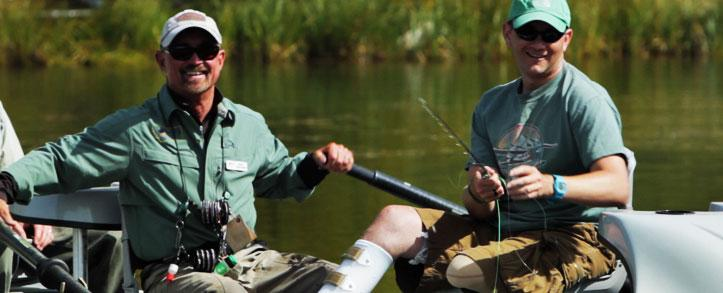 Veterans learning to fly fish.