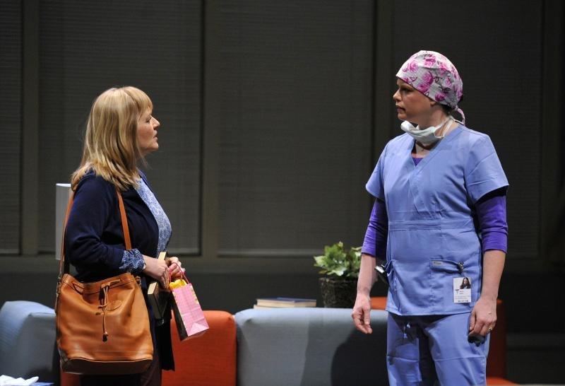 A scene from Love Alone with Julia Gibson as Helen Warren and Jenny Wales as Dr. Becca Neal.