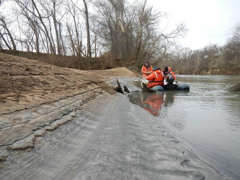 Tom Augspurger (l), USFWS, taking core sample during February 8th reconnaissance of Dan River coal ash spill. (l-r) Tom Augsperger, USFWS, John Fridell, USFWS, Rick Smith, Duke Energy. Photo by Steve Alexander, USFWS..