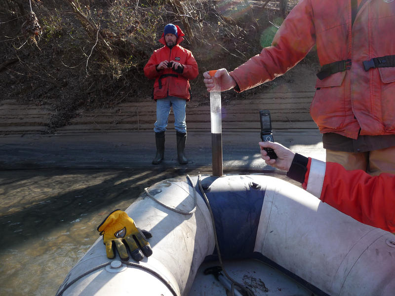 Tom Augspurger, USFWS, taking core sample as EPA's Alan Humphrey documents the ash bar during February 8th reconnaissance of Dan River coal ash spill. Photo by Sara Ward, USFWS..