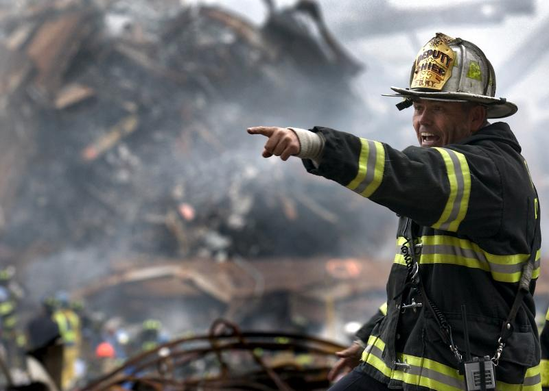 A picture of a fire fighter responding after the 9/11 attacks.