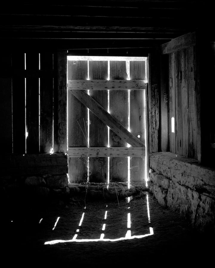 "The Light of Hope.  ""Since my first visit to Stagville, I was drawn to the light pouring into the Great Barn through the openings between the slats of the barn doors and windows.""—Brenda Scott, Photographer"