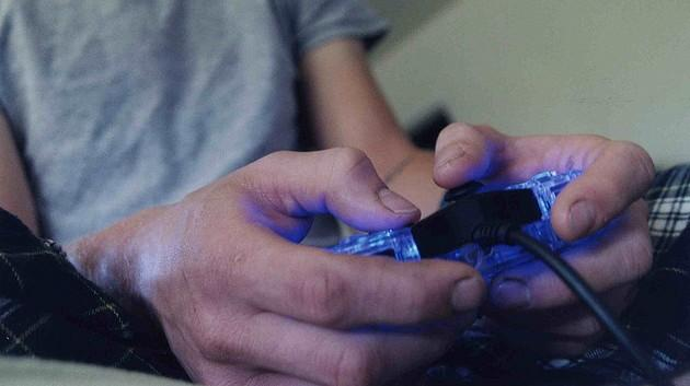 A picture of hands playing a video game controller