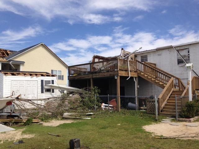 A picture of a house damged by a tornado.