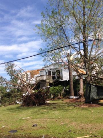 The tornado downed powerlines and sent trees into some homes.