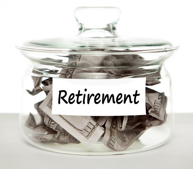 A picture of a jar of cash marked 'retirement'.