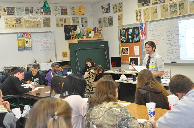 Will Michaels talks with a class at Riverside High School in Durham