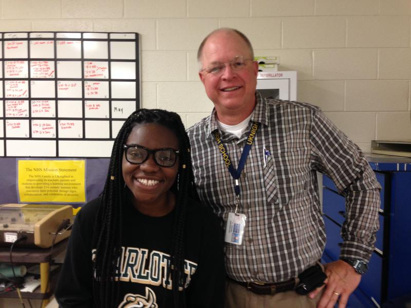 "Northern High School senior Mercy Mensah and athletic trainer Ken ""Doc"" Brown"