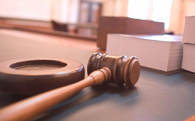 A picture of a gavel on a table.