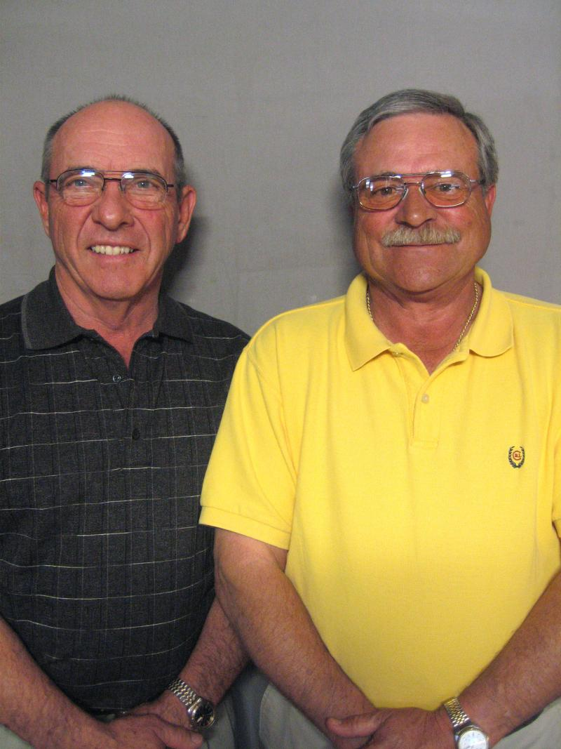 Former tobacco auctioneers Gregg Goins and Steve Nelms talk at StoryCorps about their work.