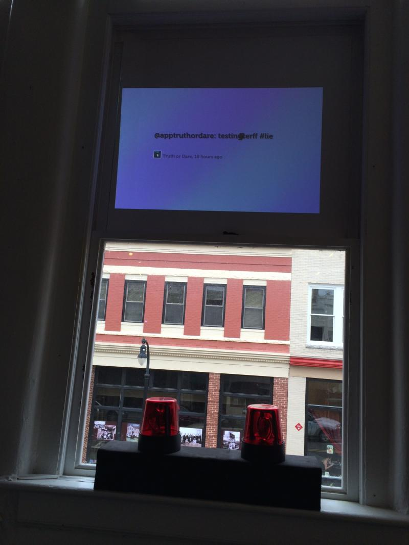 This installation piece combines a mobile app and a physical computing installation that monitors whether a tweet includes a true or false statement through biofeedback readings. By Fernanda Duarte.