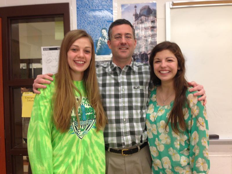 Carrboro High School junior Anna Knotek, history teacher Matthew Cone, and junior Maddie Macmillan