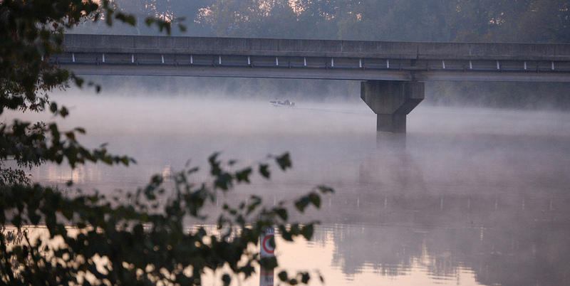 Early morning anglers heading downstream from Avent's Ferry on the Cape Fear River, near Corinth, North Carolina.