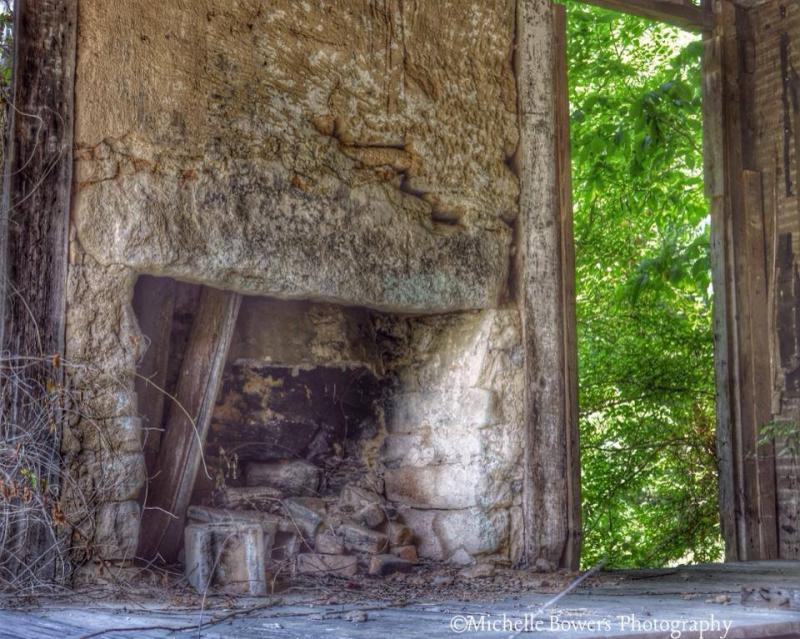This fireplace is one of four inside the house in the previous image.