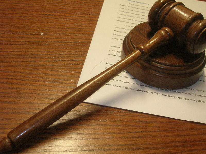 A picture of a gavel on a document.