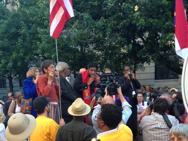 Photo: Rev. William Barber (center) is the lead organizer of the Moral Monday movement.