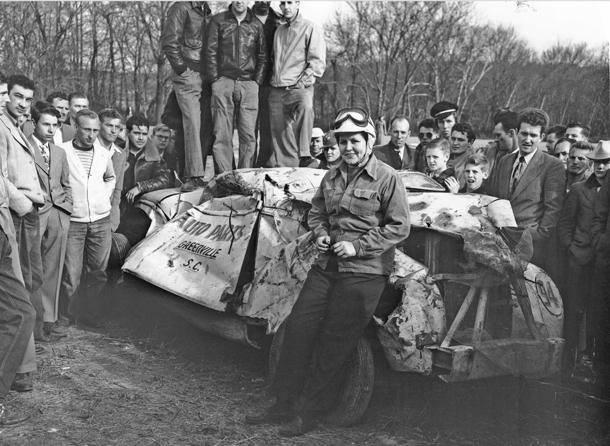 Louise Smith, an early female NASCAR driver, after a crash at Occoneechee Speedway in 1949. Smith raced during the years 1945-56.