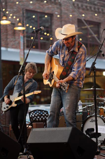 John Howie Jr. and The Rosewood Bluff performing at a Back Porch Music On The Lawn concert in 2013
