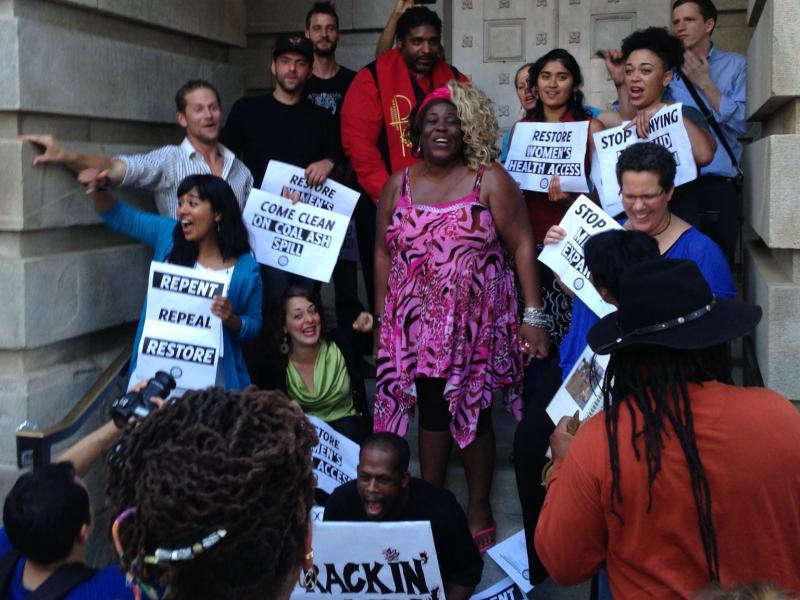 Photo: The 11 protesters who were cited for trespassing in the Old North Carolina State Capitol building on Monday.
