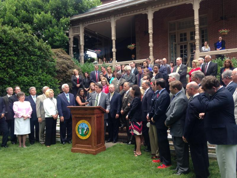 Governor Pat McCrory gathered with school leaders and legislators on Wednesday to show their support for a scaled-down spending plan that focuses on teacher pay.