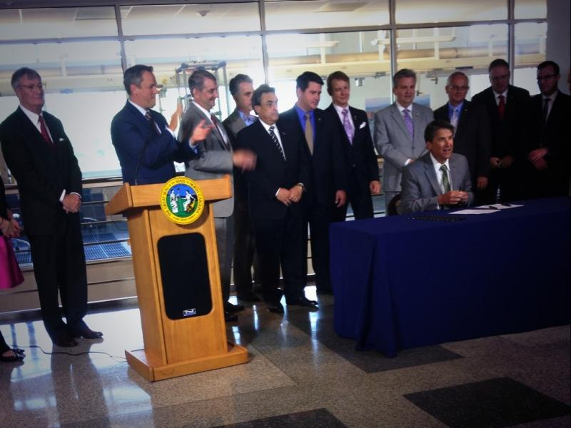 Photo: Gov. Pat McCrory signing the Energy Modernization Act at NC State University's College of Engineering building.