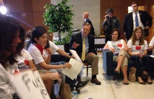 Senate Leader Phil Berger takes an impromptu meeting with Moral Monday protesters.