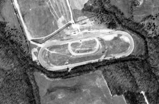 The horse racetrack enlarged to a one-mile track for auto racing. 1955 U.S.Government aerial photo.