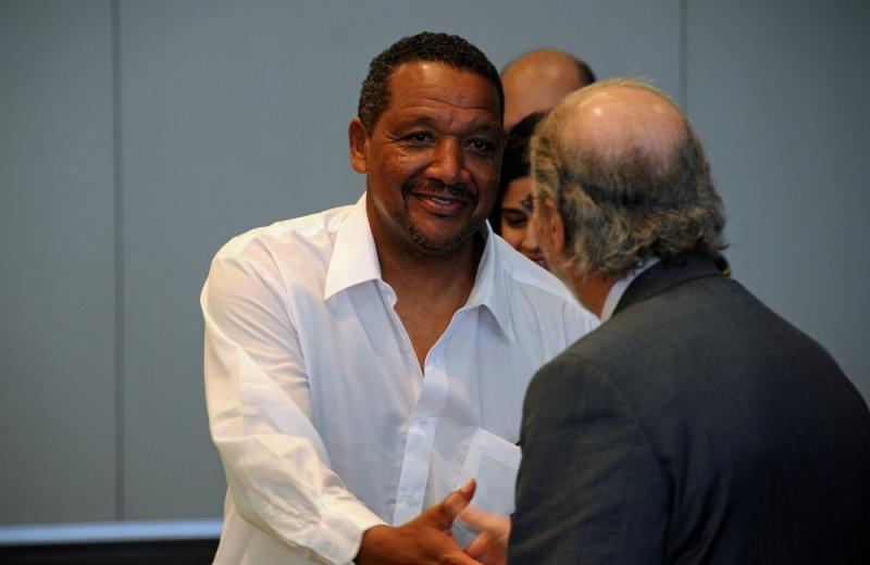 Darryl Howard greets one of his lawyers, James P. Cooney, III