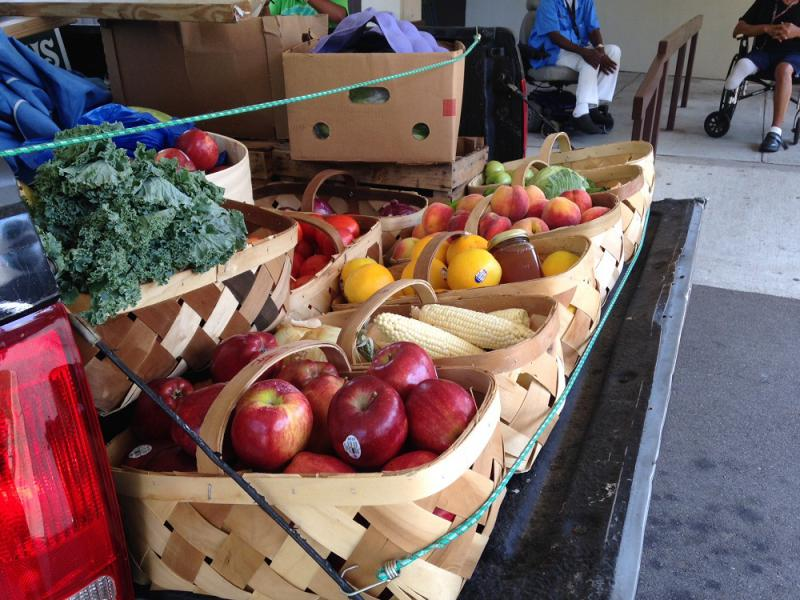 Grocers on Wheels sells food from the back of a pickup truck in Raleigh's food deserts.
