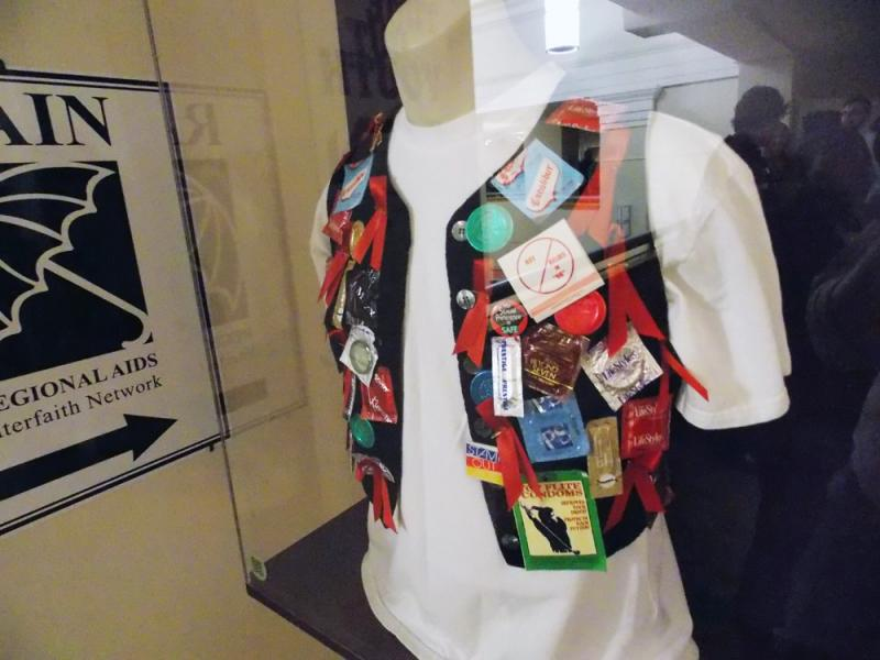 Visitors can see a vest with badges and buttons in support of the LGBTQ liyfestyle.