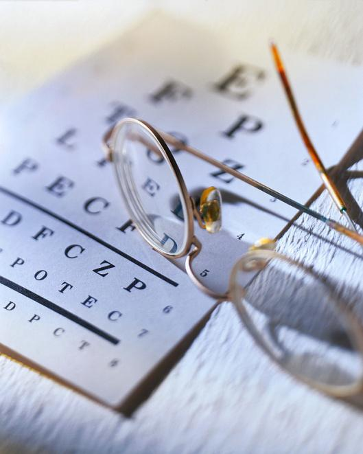 A picture of eye glasses and an eye chart.