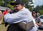 Leon Brown and Henry McCollum embrace in front of family home after their release.