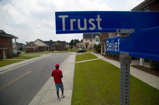 Photo of corner of Trust and Belief from News and Observer's Contracted to Cheat series.