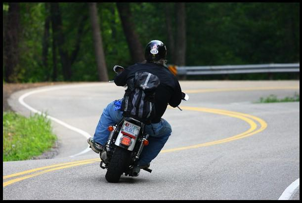 A picture of a rider on a motorcycle.