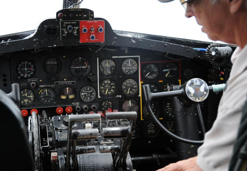 Stuart Goldstein, the current co-pilot, sits at the controls, a mixture of modern and antique technology.