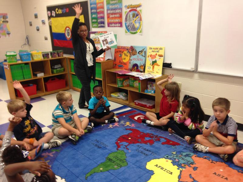Kindergarten teacher Daly Romero Espinal teaches her students basic Spanish commands on the first day of school at Martin Millennium Academy.