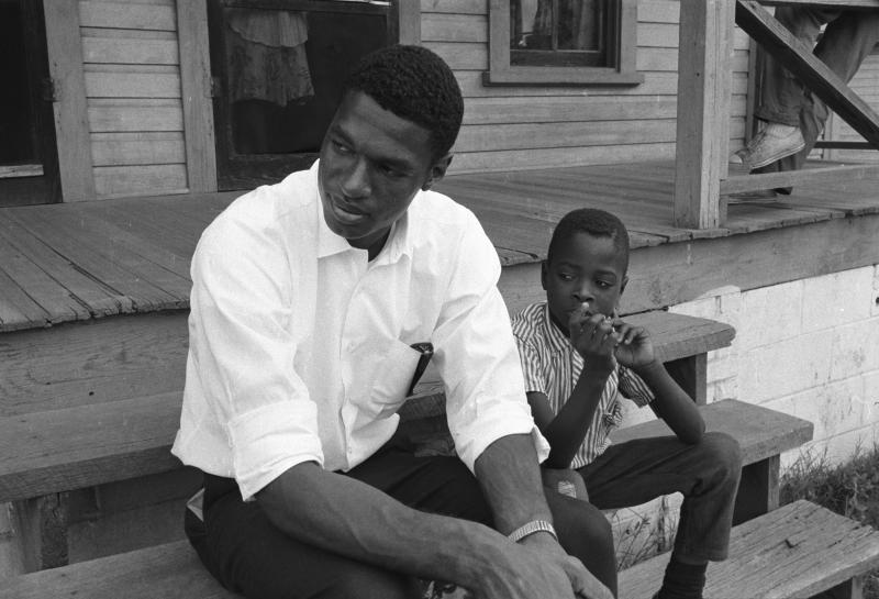 Sitting on the steps with a child soon after I arrived in Durham to work as a community organizer for Operation Breakthrough.