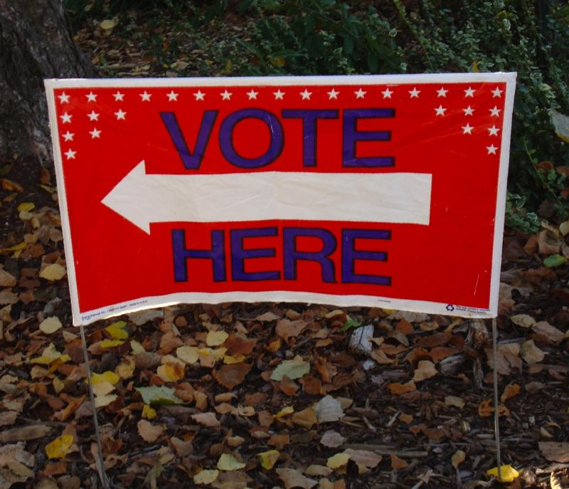 "A sign stating ""Vote Here""."
