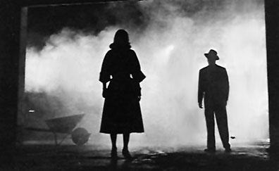 Two silhouetted figures in the 1955 film The Big Combo