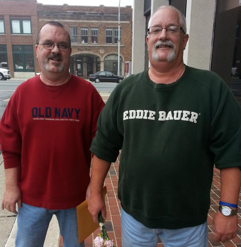 Ronald Williams (left) and David Moore, partners of 36 years, received their wedding license Monday 10/13/2014