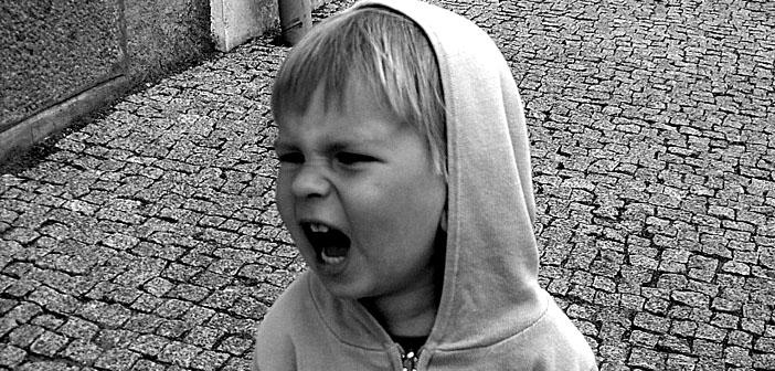 A picture of a screaming child.