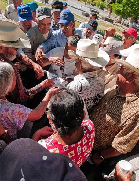 Braceros share news clippings each Sunday, returning week after week to continue their protest.