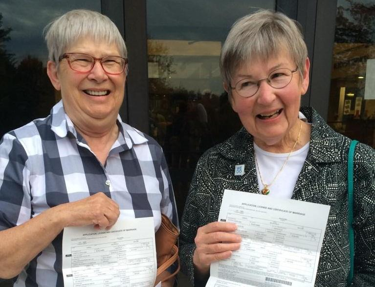 Betty Mack and Carol Taylor of Asheville, partners of 41 years, show their marriage certificate
