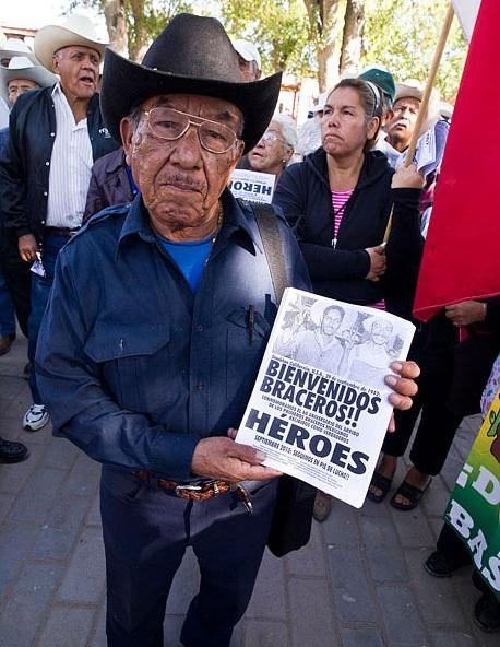 Former bracero worker Modesto Jurita holds a flyer commemorating the 68th anniversary of the 1942 arrival of workers in California.
