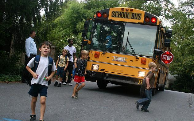 A picture of children getting off a school bus.