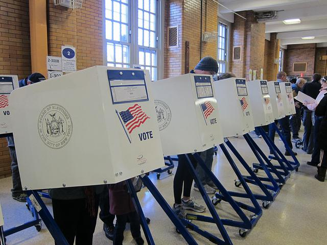 A picture of people in voting booths