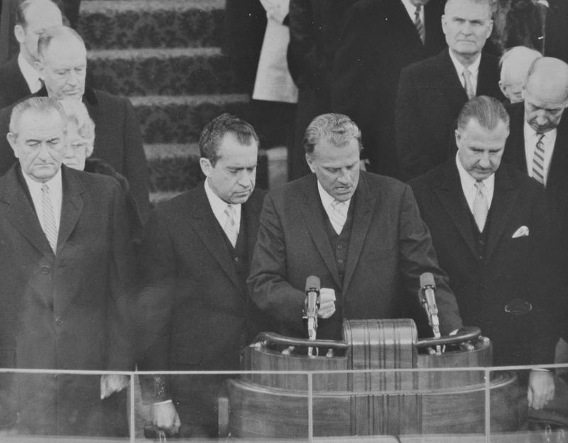 President Lyndon Johnson, President-elect Richard Nixon, Rev. Billy Graham and Vice President-elect Spiro Agnew during a prayer at swearing-in ceremony at the U.S. Capitol January 20, 1969.